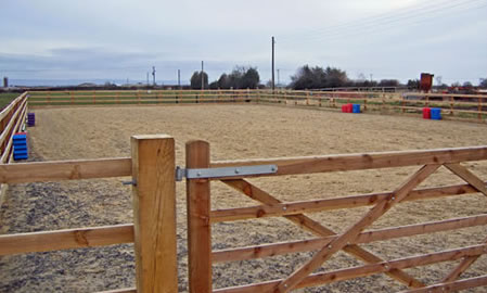 Timber gate fibre surface riding arena Yorkshire
