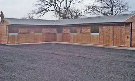 5 timber stables and store room